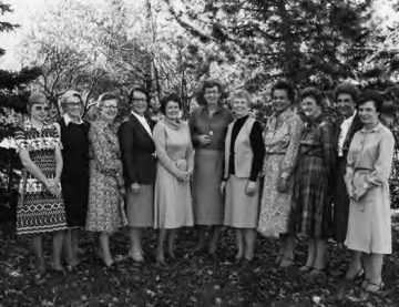 Black and White photo of row of researchers outdoors